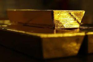Giá vàng vọt tăng sau cuộc họp Fed, USD tự do sụt mạnh