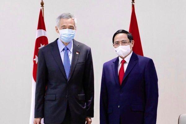 Thủ tướng Phạm Minh Chính tiếp xúc song phương với Thủ tướng Singapore