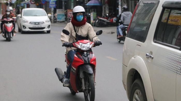 Chùm ảnh: Người dân Đà Nẵng co ro trong cái lạnh kỷ lục 5 năm qua Ảnh 2