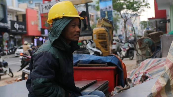 Chùm ảnh: Người dân Đà Nẵng co ro trong cái lạnh kỷ lục 5 năm qua Ảnh 8