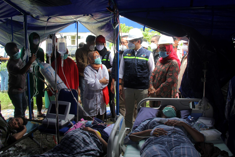 Indonesia chạy đua cứu người sau vụ động đất Ảnh 9