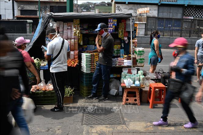 Venezuela công bố số liệu kinh tế đáng quan ngại Ảnh 1