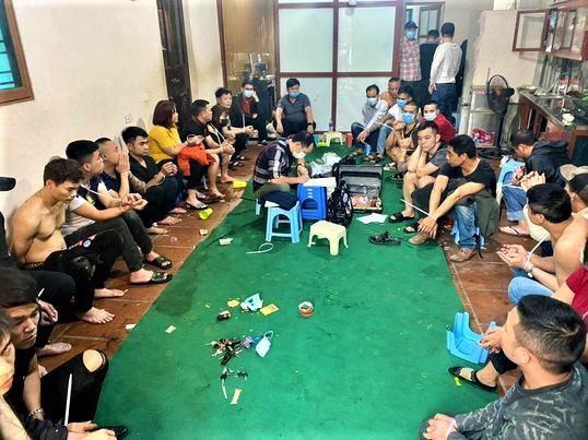 Cảnh sát đột kích xới bạc mở xuyên Tết tại Hà Nội Ảnh 1