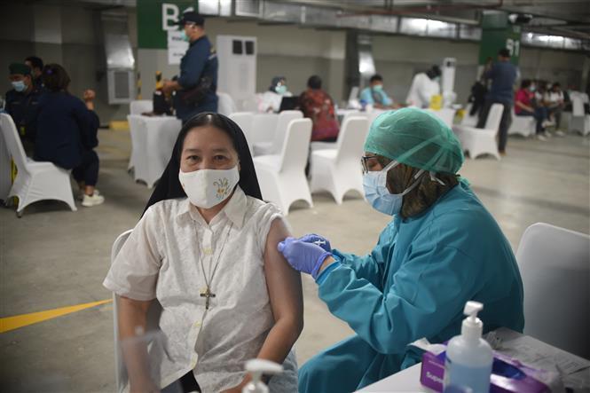 COVID-19 tại ASEAN hết 26/2: Trên 52.490 ca tử vong; Dịch 'nóng' trở lại ở Thái Lan, Philippines Ảnh 3