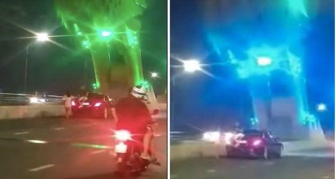 Xử phạt tài xế ngang nhiên dừng xe giữa cầu Rồng để ngắm cảnh, chụp hình Ảnh 1