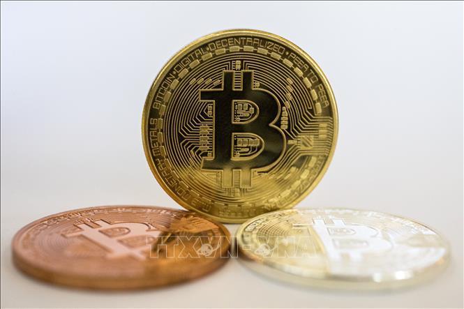 Giá trị đồng Bitcoin lần đầu tiên vượt ngưỡng 60.000 USD Ảnh 1