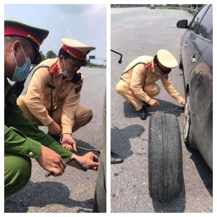 Đưa con đi khám bệnh bị hỏng xe, nữ tài xế được Đại úy CSGT giúp thay lốp Ảnh 1