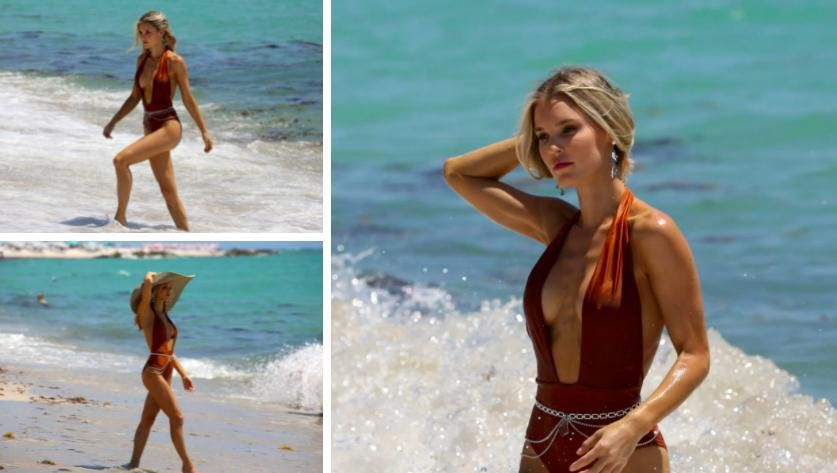 Chân dài 9x Joy Corrigan cực nóng bỏng ở biển với áo tắm xẻ sâu hút mắt Ảnh 1