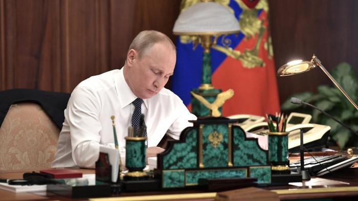 Ông Putin ký luật hợp pháp hóa quyền công dân Nga cho người dân Crimea Ảnh 1