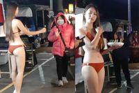 Mặc bikini đứng bán ổi bất chấp cái lạnh 9 độ C, hotgirl đốt mắt người đi đường