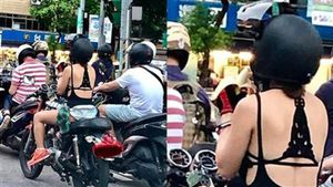 Pha hớ hênh kinh điển của cô gái đi xe máy 'phơi nội y'