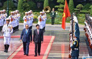 Lễ đón chính thức Thủ tướng Lào Thongloun Sisoulith tại Phủ Chủ tịch
