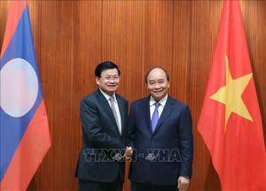 Thủ tướng Lào thăm Việt Nam và đồng chủ trì Kỳ họp lần thứ 43 Ủy ban liên Chính phủ Việt Nam - Lào