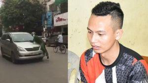 Đỗ ô tô ngược chiều, tài xế hất cảnh sát lên nắp capô rồi bỏ chạy