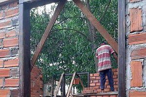 Chính quyền đau đầu với vụ xây nhà trên đất hàng xóm