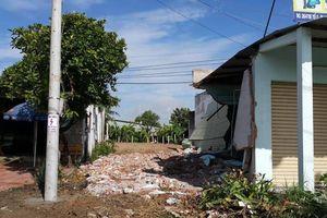 Điều tra làm rõ vụ dùng xe múc đất cùng vệ sĩ kéo đến đập nhà dân
