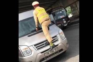 Phạt nặng tài xế làm CSGT nhảy lên túm cần gạt nước ôtô