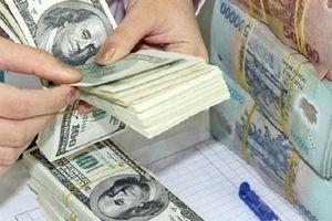 Tỷ giá trung tâm đi ngang, giá trao đổi USD thị trường tự do giảm mạnh