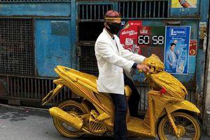 7 ngày qua ảnh: Người đàn ông đi mô tô dát vàng trên phố ở Thái Lan