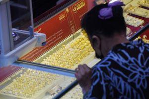 Giá vàng hôm nay 21/11: USD đi lên, vàng sụt giảm