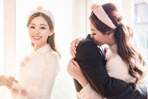 Á hậu Tường San diện áo dài đẹp dịu dàng, tay mang nhẫn kim cương 'khủng' trong ngày cưới