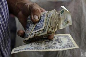 Cuba lần đầu tuyên bố phá giá đồng peso