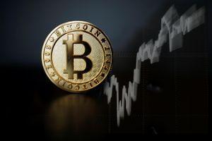 Bitcoin tiến sát kỷ lục 35.000 USD/đồng