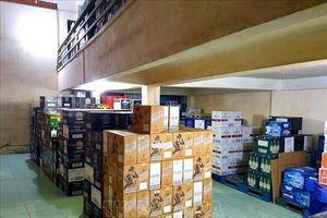Phát hiện kho chứa hàng nghìn chai rượu lậu tại TPHCM