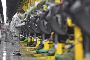 Kinh tế Trung Quốc tăng trưởng năm 2020, nhưng tiêu dùng lao dốc