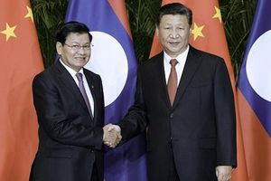 Ông Tập Cận Bình điện đàm chúc mừng Tổng Bí thư Đảng NDCM Lào
