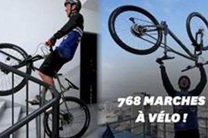 Leo cầu thang bằng xe đạp lên nóc nhà chọc trời