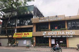 Không bị cấm, nhiều hàng quán ở Hà Nội vẫn 'cửa đóng then cài'