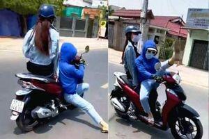 'Cô gái' đi xe máy diễn xiếc trên đường bị công an triệu tập