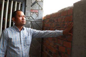 Chủ tịch huyện yêu cầu kiểm tra vụ xây tường chắn cổng nhà hàng xóm