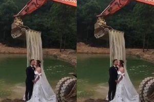 Dùng máy xúc chụp ảnh cưới dưới thác nước