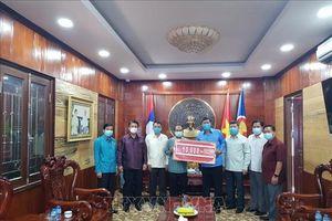 Lào chung sức cùng Việt Nam trong cuộc chiến chống dịch bệnh