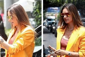Alessandra Ambrosio diện blazer màu cam nổi bật đi ăn trưa cùng bạn bè