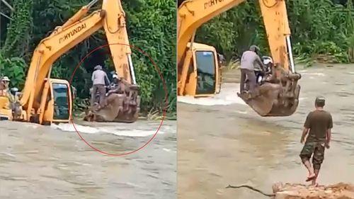 Máy xúc đưa người qua sông ở Campuchia