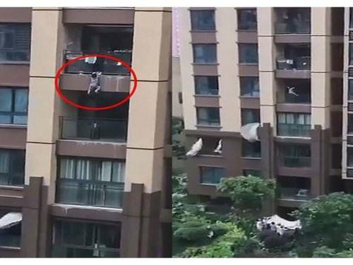 Dùng chăn đỡ an toàn bé trai rơi từ tầng 6