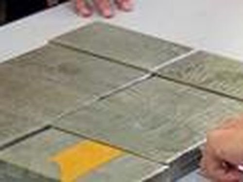 Mua 10 bánh heroin từ Trung Quốc về tiêu thụ