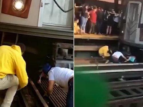 Bị bố lôi vào gầm tàu tự tử, cô bé 5 tuổi thoát chết trên đường ray