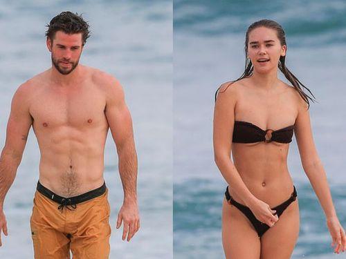 Liam Hemsworth tắm biển bên người tình trẻ