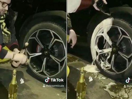 Rich Kid rửa lốp xe Lamborghini bằng rượu sâm panh đắt tiền để xem chai nào giúp xe đi sướng hơn