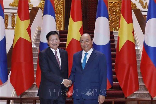 Thủ tướng Lào thăm Việt Nam đồng chủ trì Kỳ họp 42 Ủy ban liên Chính phủ Việt Nam-Lào
