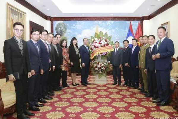 Thứ trưởng Ngoại giao Nguyễn Quốc Dũng chúc mừng Quốc khánh CHDCND Lào