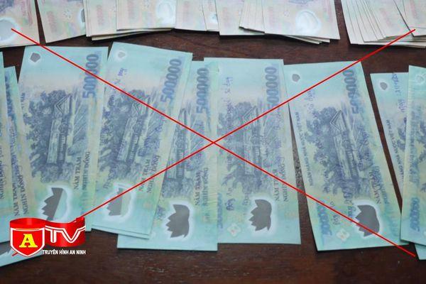 Hành vi làm, tàng trữ, vận chuyển và lưu hành tiền giả bị pháp luật xử lý như thế nào?