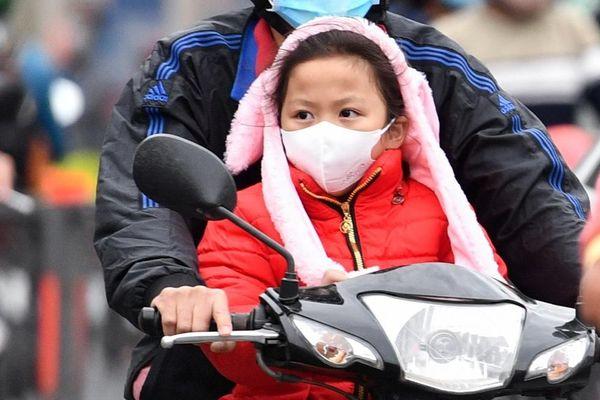Người TP.HCM mặc áo ấm trong ngày 21 độ C