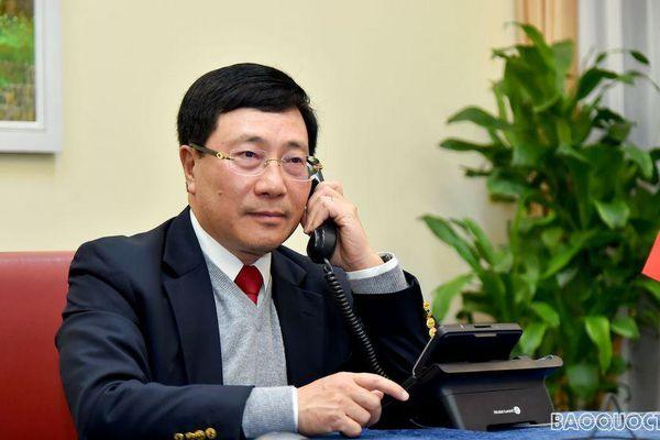 Phó Thủ tướng Phạm Bình Minh điện đàm Cố vấn An ninh quốc gia Hoa Kỳ về việc điều tra chính sách tiền tệ của Việt Nam