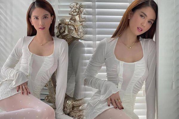 Vẻ đẹp thơ ngây 'chết người' của Ngọc Trinh trong chiếc váy trắng tinh khôi