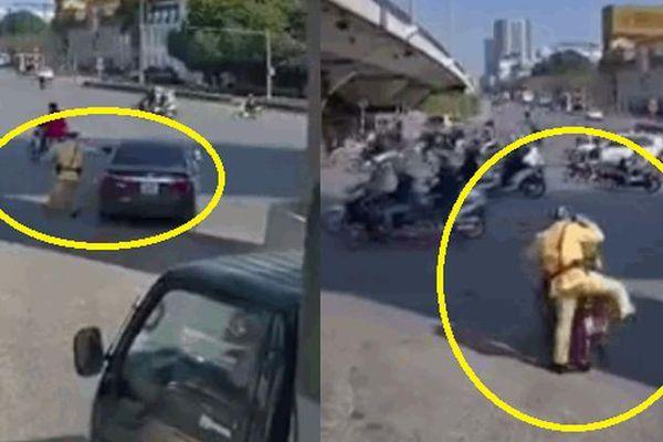 Chiến sĩ CSGT nhảy lên xe ôm nhờ đuổi theo ô tô vi phạm bỏ chạy